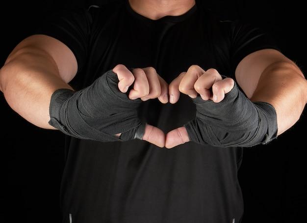 Atleta mostra o símbolo do coração Foto Premium