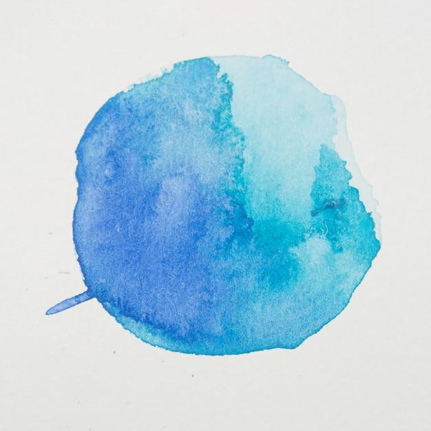 Azul pinta em forma de círculo em papel branco Foto gratuita
