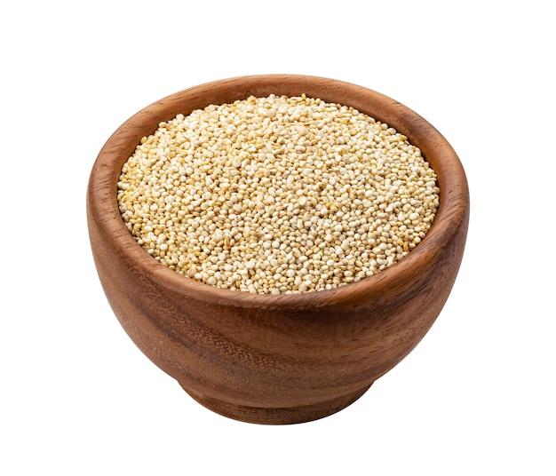 Bacia de madeira de sementes de quinoa isoladas Foto Premium