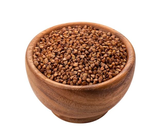 Bacia de madeira marrom com grão seco seco do trigo mourisco Foto Premium