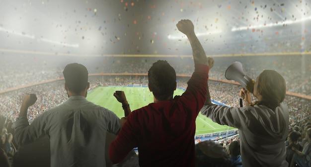 Backview de fãs de futebol no estádio Foto gratuita