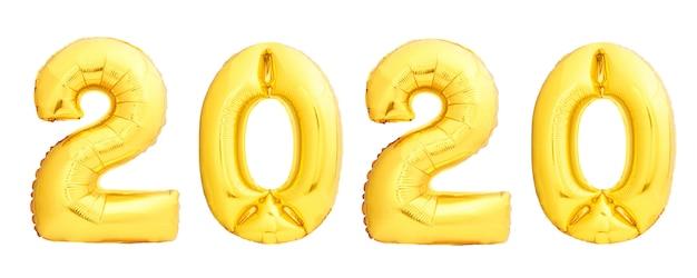 Balões de natal dourado 2020 feitos de balões infláveis dourados isolados. feliz ano novo 2020 Foto Premium