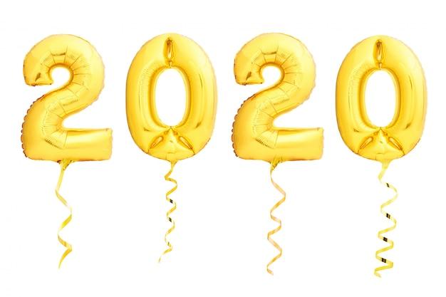 Balões dourados do natal 2020 feitos de balão inflável com fita dourada no branco Foto Premium