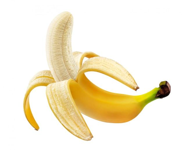 Banana descascada isolada no fundo branco com traçado de recorte Foto Premium