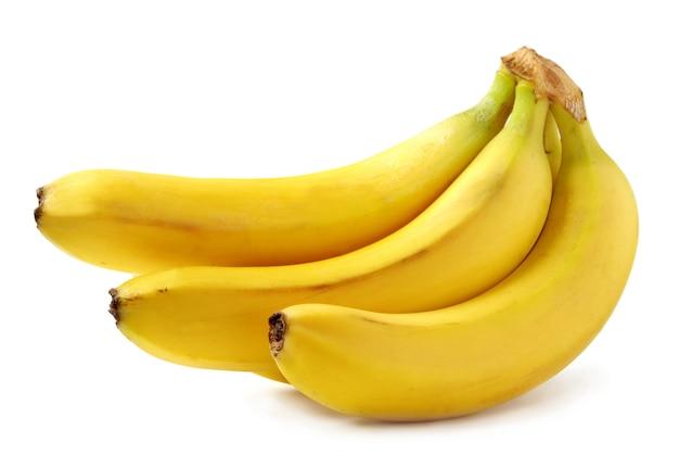 Bananas amarelas brilhantes em branco Foto Premium