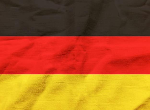 Bandeira da alemanha com textura no fundo Foto gratuita