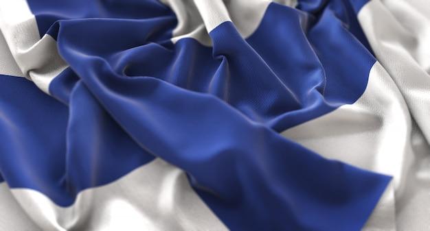 Bandeira da finlândia ruffled beautifully waving macro close-up shot Foto gratuita