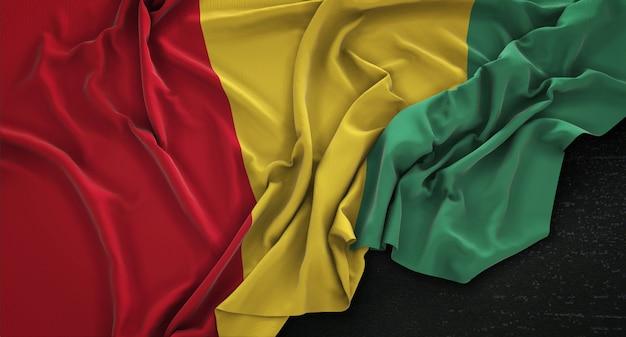 Bandeira da guiné enrugada no fundo escuro 3d render Foto gratuita