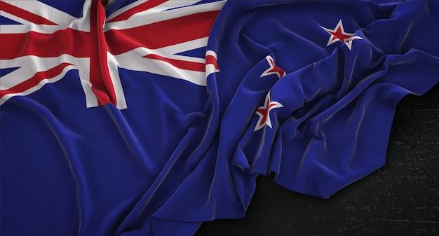 Bandeira da nova zelândia enrugada no fundo escuro 3d render Foto gratuita