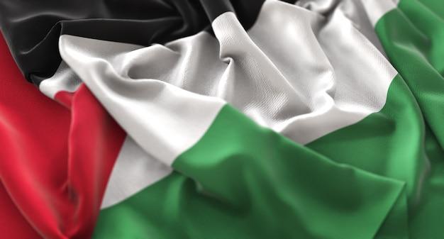 Bandeira da palestina ruffled beautifully waving macro close-up shot Foto gratuita
