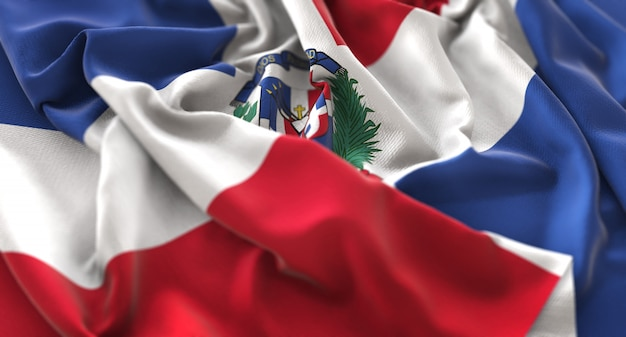 Bandeira da república dominicana ruffled beautifully waving macro close-up shot Foto gratuita