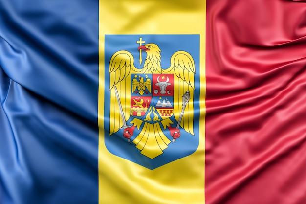 Bandeira da roménia com brasão Foto gratuita