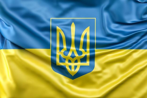Bandeira da ucrânia com brasão Foto gratuita