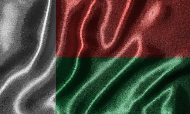 Bandeira de madagascar - bandeira do tecido do país de madagáscar, fundo da bandeira de ondulação. Foto Premium