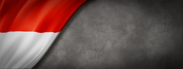 Bandeira de mônaco na parede de concreto Foto Premium