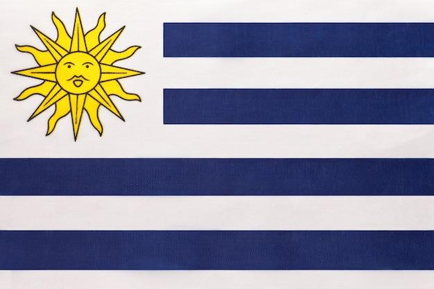 Bandeira de tecido nacional do uruguai, fundo de têxteis. símbolo do país internacional da américa do sul no mundo. Foto Premium
