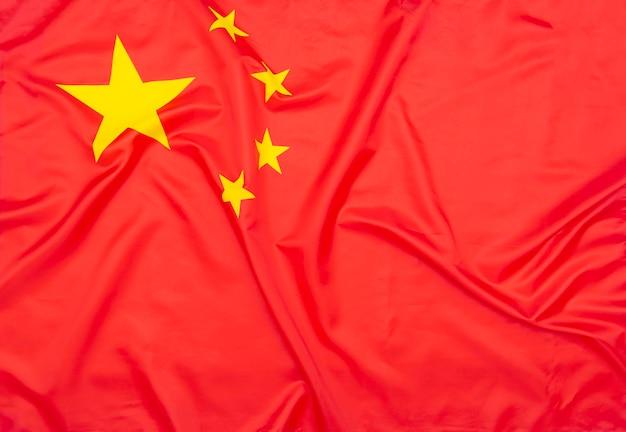 Bandeira de tecido natural real da china ou bandeira nacional da república popular da china como textura ou plano de fundo Foto Premium