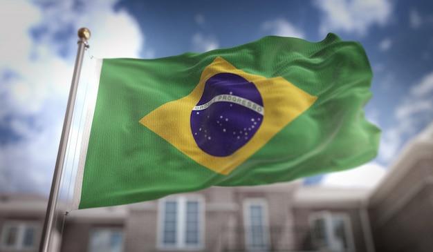 Bandeira do brasil 3d rendering no fundo do edifício do céu azul Foto Premium