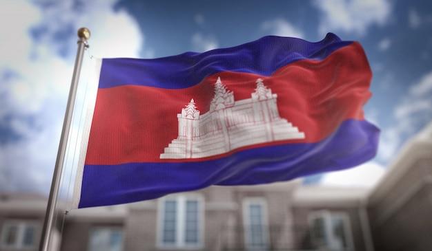 Bandeira do camboja 3d rendering no fundo do edifício do céu azul Foto Premium