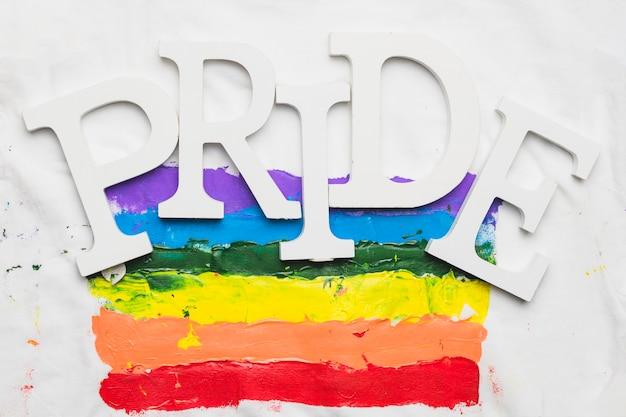 Bandeira do orgulho gay em aquarela com slogan Foto gratuita
