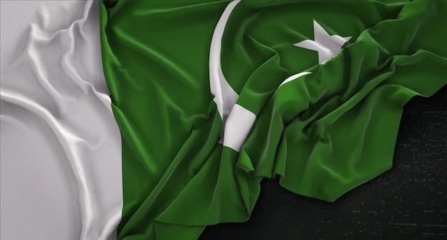 Bandeira do paquistão enrugada no fundo escuro 3d render Foto gratuita