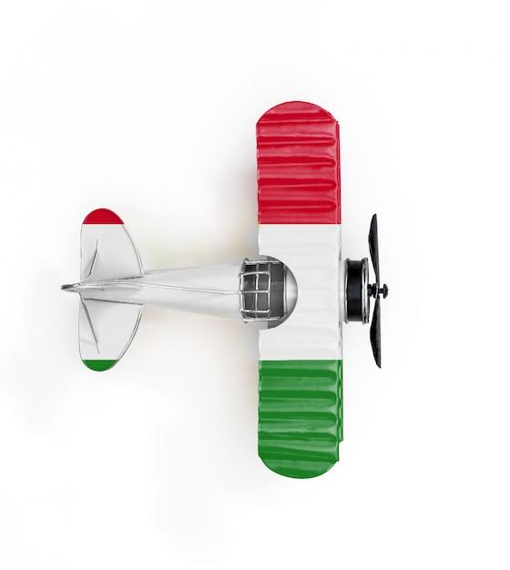 Bandeira nacional da hungria viajar avião de brinquedo de metal isolado no branco Foto Premium