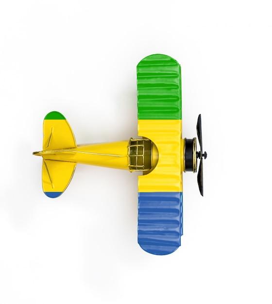 Bandeira nacional do gabão viajar avião de brinquedo metal isolado no branco Foto Premium