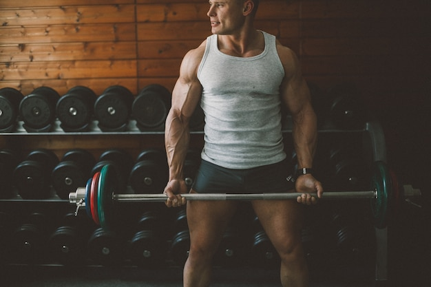 Barbell poder força atleta adulto Foto gratuita