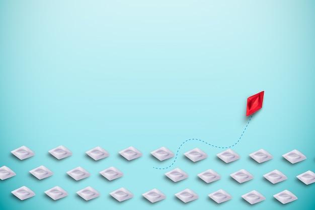 Barco de papel vermelho navegando fora do mar virtual de barco de papel branco. perturbação novo normal para descobrir novos negócios e conceito de pensamento diferente. Foto Premium