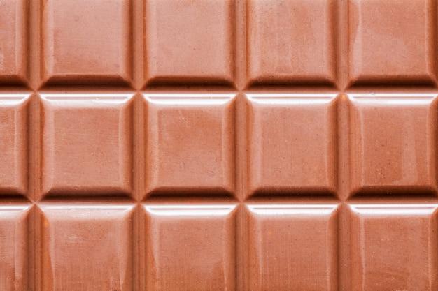 Barra de chocolate escura como plano de fundo Foto Premium