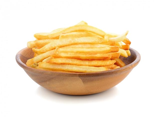 Batatas fritas apetitosas em um branco Foto Premium