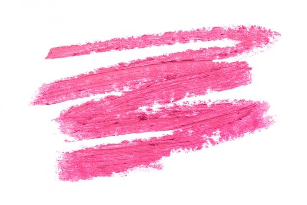 Batom vermelho sobre fundo branco Foto Premium