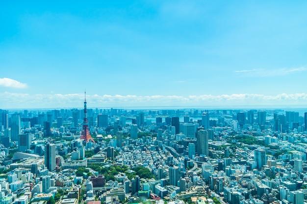Bela arquitetura edifício cidade de tóquio com torre de tóquio Foto gratuita