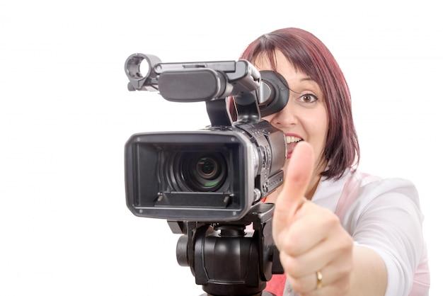 Bela jovem com uma câmera profissional Foto Premium
