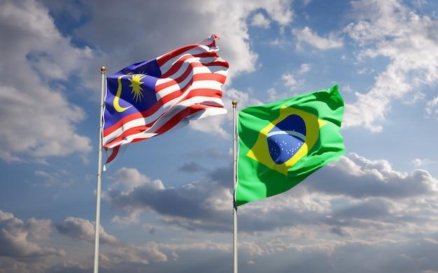 Belas bandeiras estaduais da malásia e do brasil juntas no céu azul Foto Premium