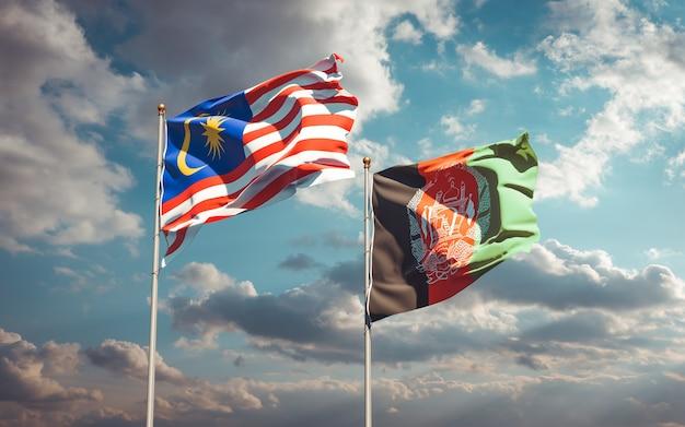Belas bandeiras estaduais do afeganistão e da malásia Foto Premium