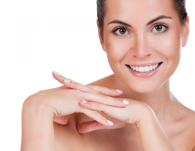 Belo rosto de mulher adulta jovem com pele fresca limpa Foto Premium