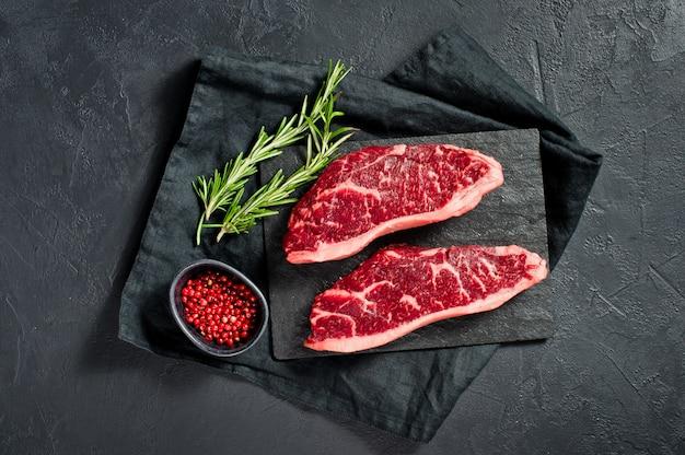 Bife de carne marmoreada preto angus Foto Premium