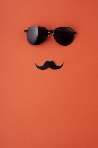 Bigodes de papel preto com óculos com espaço de cópia. mês de conscientização da saúde dos homens, masculinidade, conceito de dia dos pais Foto Premium