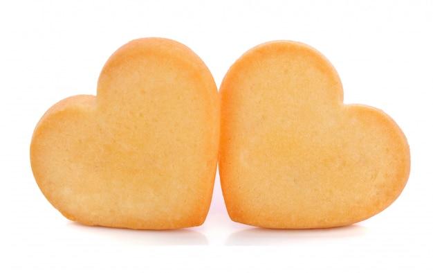 Biscoitos de forma de coração isolados no branco Foto Premium