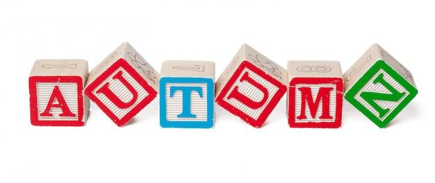Blocos de alfabeto colorido. outono de palavra isolado Foto Premium