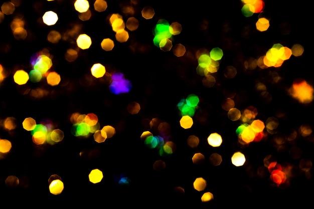 Bokeh acende em preto. fundo de natal bonito, conceito de ano novo. Foto Premium