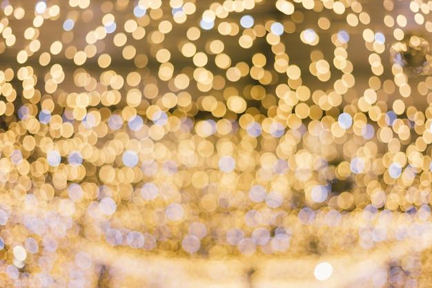 Bokeh circular abstrato claro colorido do natal e do fundo do ano novo feliz. Foto Premium