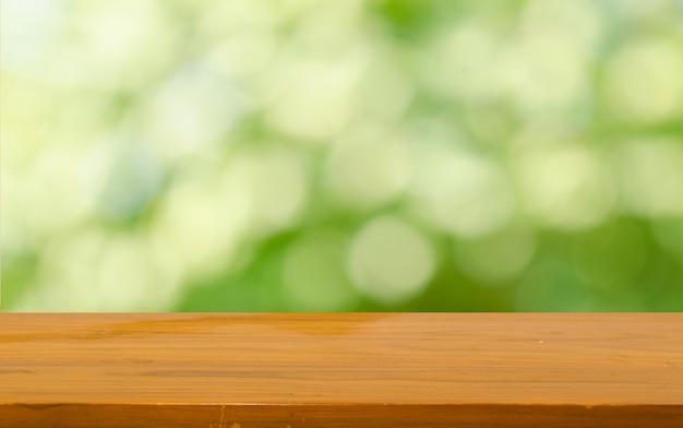 Bokeh de mesa de madeira Foto Premium