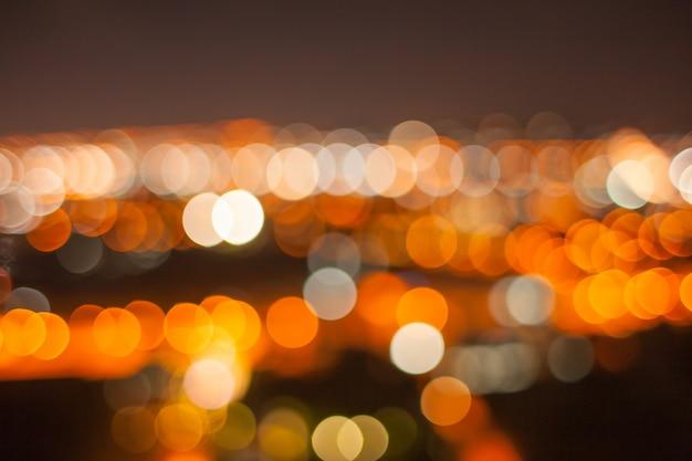 Bokeh de ouro abstrato na noite da cidade Foto Premium
