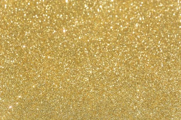 Bokeh de ouro Foto gratuita