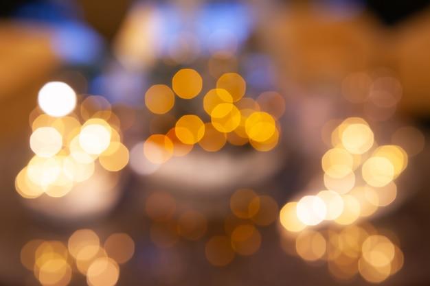 Bokeh desfocado luzes, luzes festivas e clima de natal Foto Premium