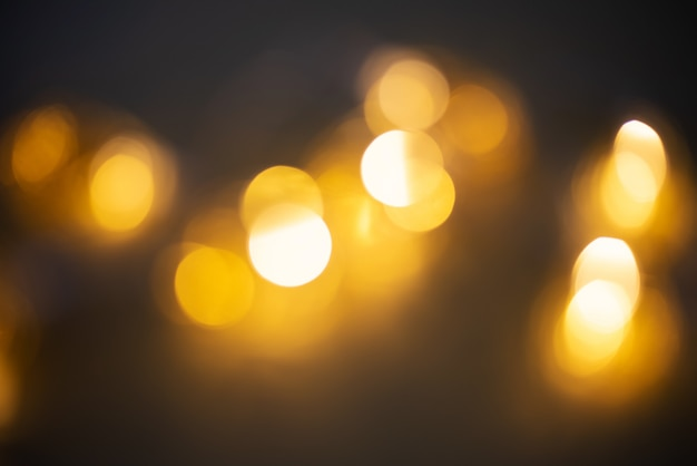 Bokeh dourado na luz guirlanda turva Foto Premium