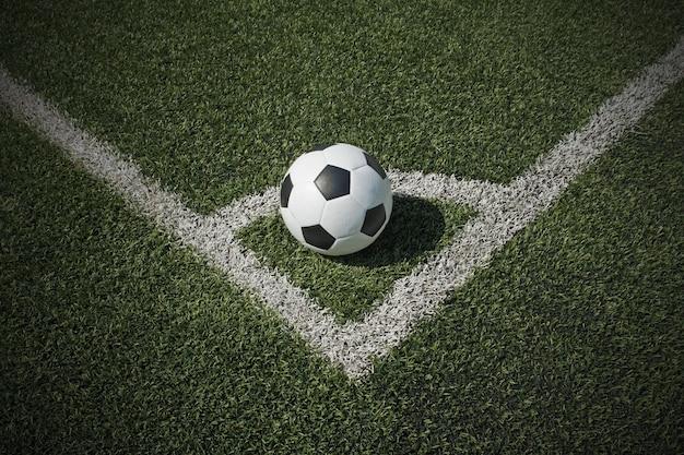Bola de futebol no campo da esquina Foto Premium