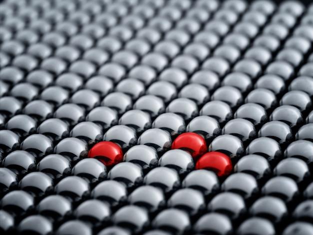 Bola vermelha entre as esferas brancas, destacando-se no conceito de multidão Foto Premium